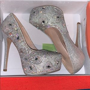 Shimmery silver heels with rhinestones